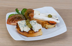 Tapas with soft cheese Stock Image