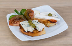 Tapas with soft cheese Royalty Free Stock Images
