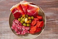 Tapas of Spain with ham olives sausage chorizo Stock Photo