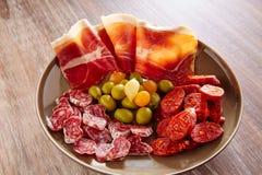 Tapas of Spain with ham olives sausage chorizo Stock Photos
