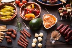 Tapas - spanish starters on table Stock Photo