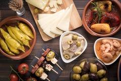 Tapas - spanish starters on table Stock Photos