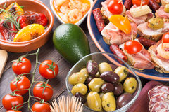 Tapas - spanish starters on table Royalty Free Stock Images