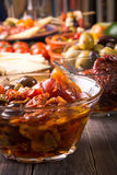Tapas starters on wooden table Stock Image