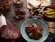 Tapas starters on wooden table Stock Images