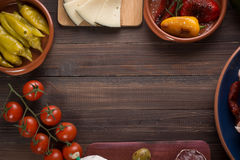 Tapas starters on wooden table Royalty Free Stock Image