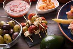 Tapas starters on wooden table Stock Photo