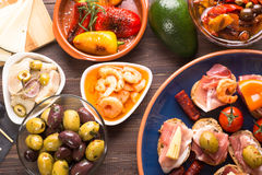 Tapas starters on wooden table Royalty Free Stock Photos