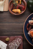 Tapas starters on wooden table Stock Photography