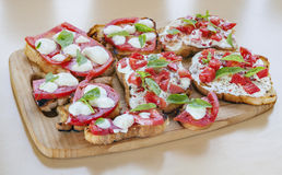 Tapas toasts cheese tomatoes Royalty Free Stock Photos