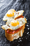 Tapas. Typical spanish food tapas: Quail eggs and sobrada of Mallorca Royalty Free Stock Photography