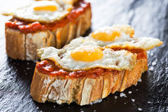 Tapas. Typical spanish food tapas: Quail eggs and sobrada of Mallorca stock photo