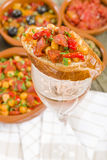 Tapas on Wine Glass Royalty Free Stock Photography