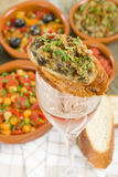 Tapas on Wine Glass Stock Images