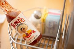 Tapatio hot sauce on the table royalty free stock images