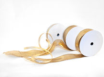 Tape. Three different types of gold ribbons on white background Royalty Free Stock Photography