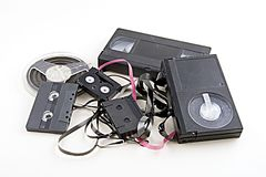Tape. Obsolete magnetic tape formats in a trash pile with all logos and trademarks removed Stock Image