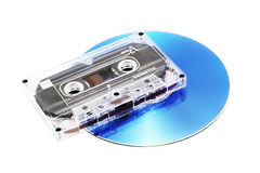Tape Cassette and CD. Analog audio tape cassette and digital compact disk on a white background Royalty Free Stock Photos
