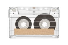 Tape cassette with label. Tape cassette with space of brown paper label for text  isolated on white background Royalty Free Stock Photos