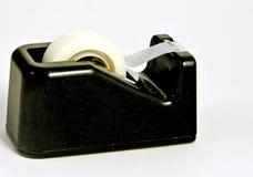 Tape Dispenser. Full Roll of Tape Ready to be Dispensed Royalty Free Stock Photo