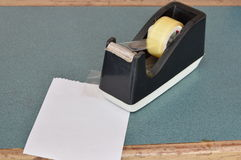 Tape dispenser and paper note on counter cashier in shop Stock Images