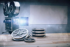 The tape of film and camera on the wooden table and blank pictur Stock Images