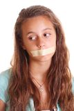 Tape on girl's mouth Royalty Free Stock Photos