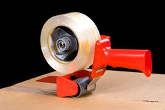 Tape gun and box Royalty Free Stock Image