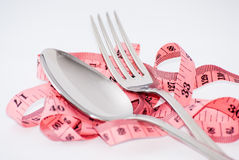 Tape line spoon and fork. Red tape line white background spoon and fork Stock Image