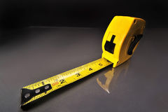 Tape Measure. Yellow Tape Measure ready for the housing market comeback Stock Images
