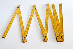 Tape measure. Yellow tape measure on white Royalty Free Stock Photography