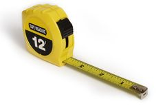Tape Measure. A Yellow Tape Measure on a white background Stock Images