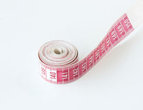 Tape measure. Wrapped up and on white background Royalty Free Stock Image