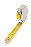 Tape Measure. Silver steel tape measure isolated against a white background stock image