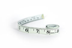 Tape measure. A tape measure showing 6 7 and 8 inches Royalty Free Stock Photo