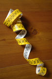 Tape Measure. Tangled Tape Measure on table Royalty Free Stock Photography