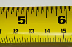 Tape measure. Close up of a section of metal tape measure with white background Stock Image