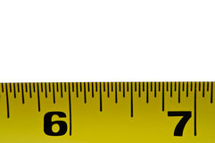 Tape measure. Close up of a section of metal tape measure arranged horizontally in the lower portion of the image with white background Royalty Free Stock Photo