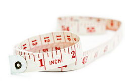 Tape measure. On white background Royalty Free Stock Photo