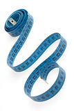 Tape measure. Whirled blue tape measure on white Stock Photos