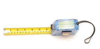 Tape Measure. Photograph of a tape measure shot in studio and isolated on white Royalty Free Stock Image