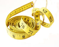 Tape measure. Coiled and unraveling royalty free stock images