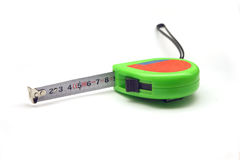 Tape measure. Green tape measure isolated on white background stock photos