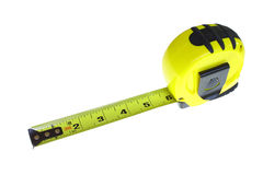 Tape measure. An extended tape measure isolated on white with room for your text Royalty Free Stock Photography