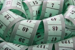 Tape measure. Disorderly the tape measure for tailor Royalty Free Stock Images