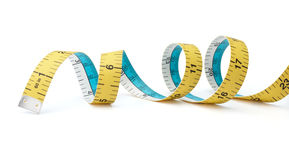 Tape measure. Swirling tape measure  on white background Stock Images