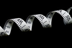 Tape Measure. Isolated on a black background, horizontal Stock Images