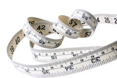 Tape measure. White rolled up tape measure Royalty Free Stock Photos