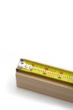 Tape Measure. On a piece of wood Royalty Free Stock Photos