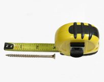 Tape measure. Closeup of tape measure with extended blade and screw Royalty Free Stock Photography
